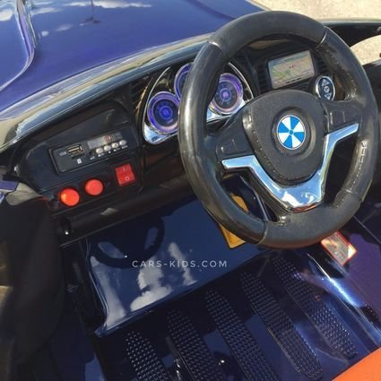 Электромобиль BMW X5 F15 синий (колеса резина, кресло кожа, пульт, музыка, усиленный аккумулятор)